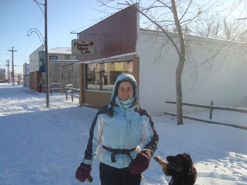 Caitlin opened a restaurant in Val Marie, the Harvest Moon Cafe. This is her, in front of it.
